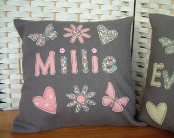 Grey denim/pink personalised cushion/pillow cover. Name, hearts, flowers, butterflies. Free-motion embroidered applique..