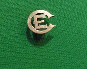 B313)  Antique Church of England CE pin marked PAT. MCH 1888