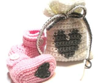 Baby girl gender reveal, pregnancy reveal, baby shower gift.  Crochet baby booties in handmade bag with heart.