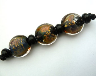 fire opal lentil lampwork beads