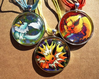 1.5 inch Diameter Flareon Jolteon Vaporeon HOLO JUNGLE Rare Pendant Charm made from Trading Cards