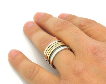 Wide spinner ring with gold swivel bands