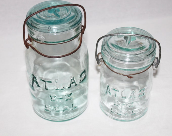 Antique Pair of Blue Atlas E-Z Seal Mason Jars with Glass Lids and wire Bails.