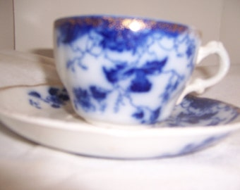 FLOW BLUE CUP and saucer