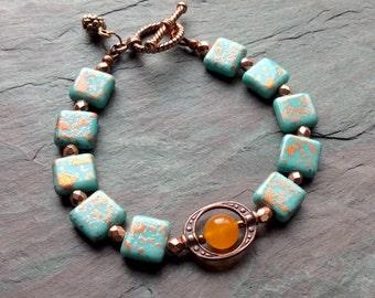 "Turquoise Czech Glass Bracelet / Square Beads / Shiny Copper Beads / Orange Quartz Bead / Pine Cone Charm / Copper Toggle - 8"" long - B22"