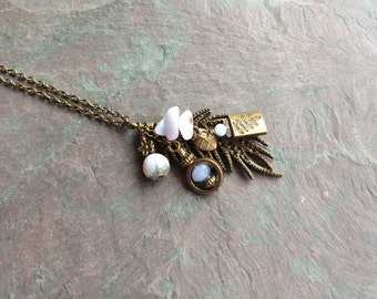 "Antique Brass Charm Necklace /One-of-a-Kind /  Light Blue / Stone / Bead / Long / Chain / Leaf / Charms - 30"" long - N28"