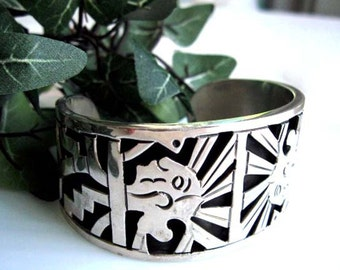 Taxco Sterling Bracelet Cuff, Aztec Glyphs Symbols, Heavy Oxidized Tribal Faces, Pre Columbian Warrior Head High Relief Figures