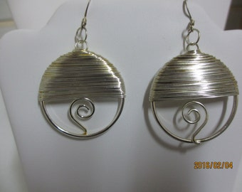 Cute silver toned earrings