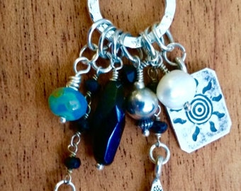 Long sterling charm necklace with Swarovski crystals and sterling charms.