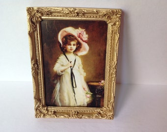 Dollshouse print of a girl in white dress and pink hat