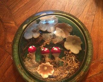 Glass paperweight with toad stools and flowers fairy