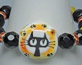 CATTITUDE:  Artist Lampwork Glass Bracelet Yellow Orange Black Cat with an Attitude!!!