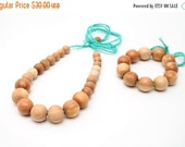 25% off Natural wooden beaded bib necklace and bracelet in juniper wood with aqua blue crochet cord, eco friendly fashion. Organic nursing n