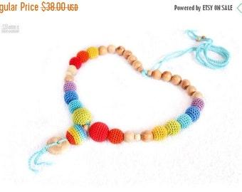 SALE 25% off Nursing necklace Double rainbow juniper crochet nursing necklace Babywearing mom necklace