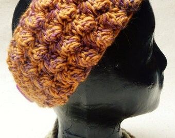 Adjustable, warm, textured headband/earwarmer crocheted in thick mustard-colored yarn accented with a multi yarn