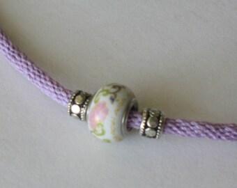 Violet kumihimo braid bracelet with floating beads