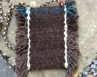 Hand woven shoulder pouch