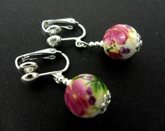 A pair of cute little porcelain flower  bead   dangly clip on earrings.