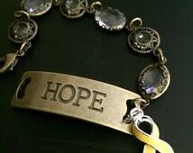 Yellow Ribbon Hope Bracelet - Adenosarcoma / Bladder Bone Liver Cancer / Osteosarcoma Survivor / Sarcoma / Spina Bifida Awareness
