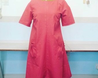 Fabulous pink dress, loose fitting with large pockets and short sleeves. A line, swing,shift dress is a UK size18 Plus size and US size 14