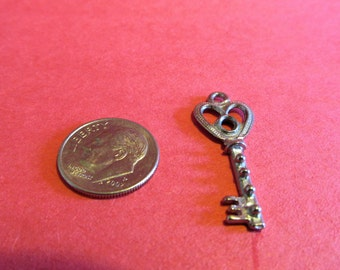 Dozen Pewter Key Charms