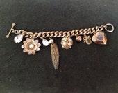 chunky brass vintage charm bracelet with fun charms