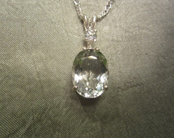 Top Bright Mint Green Prasiolite Amethyst accented pendant.