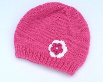 Baby girl hand knitted raspberry pink baby beanie hat to fit 3 to 6 months. Baby accessories and baby clothes