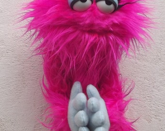 Sr.  Rosita the peaceful monster ,  Enjoyable pink monster puppet wooden rods