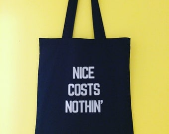 Nice costs nothin'! Positive message, long handled, reusable tote bag. Perfect for the market, beach, gym, city, library, village shop!