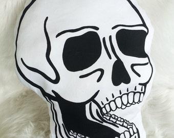 Screen printed skull throw pillow
