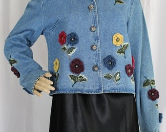 Jean jacket with floral embellishment