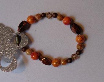 Orange, brown and gold beaded bracelet
