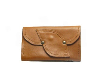 Handmade leather purse with leaf