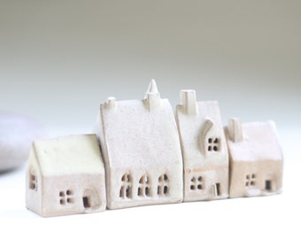 Small clay houses.  Shelf village of 4 ceramic buildings. Housewarming present. Pottery houses. Clay Birthday present. Ceramic houses