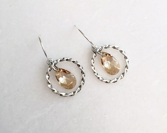 Twisted silver hoops with golden Swarovski crystal