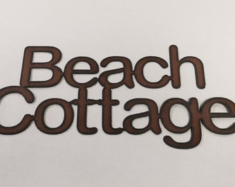 Beach Cottage sign made out of rusted metal