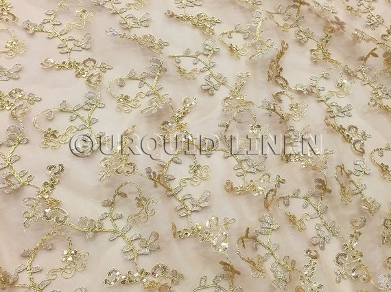Basil leaf embroidery fabric in gold lace w floral