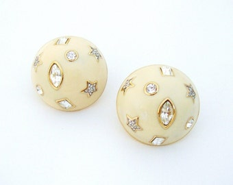 GUY LAROCHE – Round domed ivory enamelled clip earrings encrusted with crystals signed
