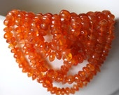 Carnelian Beads . Smooth Rondelle Beads . 4 to 5 mm . 7 Inch Strand
