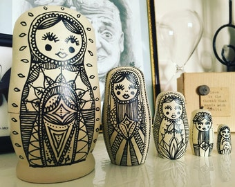 Large cream Russian doll set