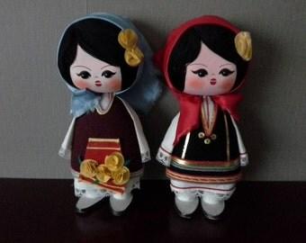 Pair of big headed dolls
