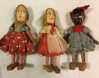 Vintage wooden moveable dolls with painted faces/German?