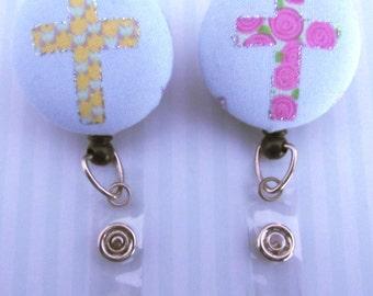 Cross badge reels