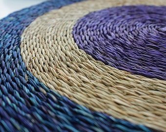 Set of 2 African placemats 31cm in diameter: Contrasting blue, natural and purple grasses are woven together to create a circular pattern