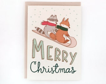 A2 Christmas/Holiday card - Tobogganing Fox & Raccoon