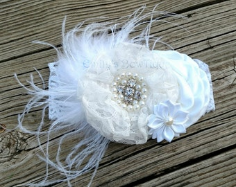 Over the top White lace headband with feathers and bling boutique bow