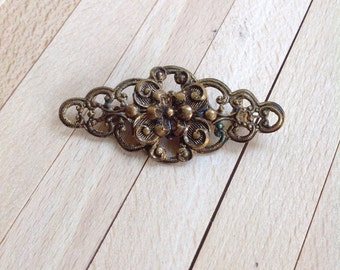 Classic vintage brooch in bronze