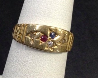 18ct gold pinkie ring , set with red white and blue stones