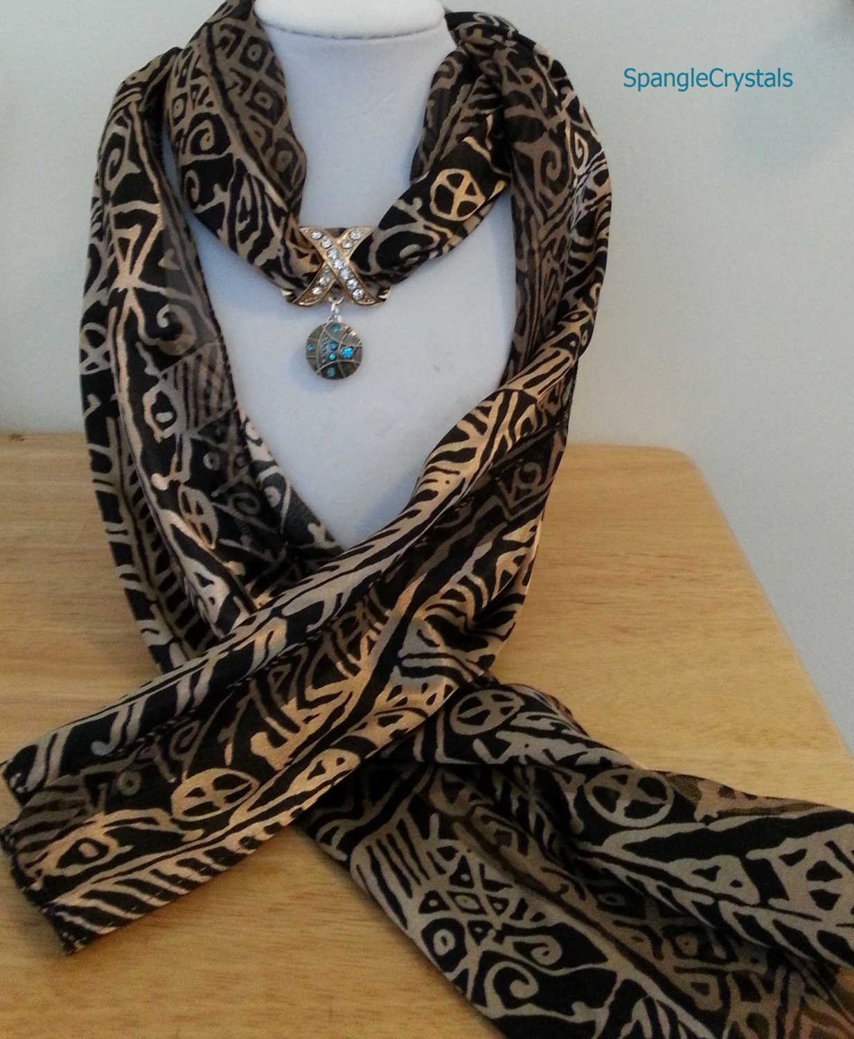 stylish black and gold scarf with jeweled scarf holder and